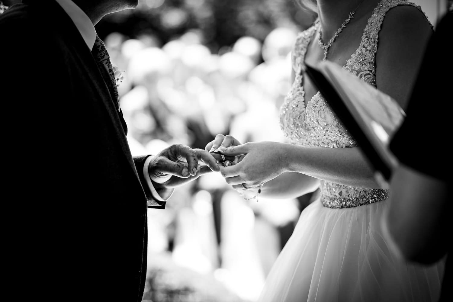 Warwick House Wedding Photography captures bride and groom exchanging wedding rings