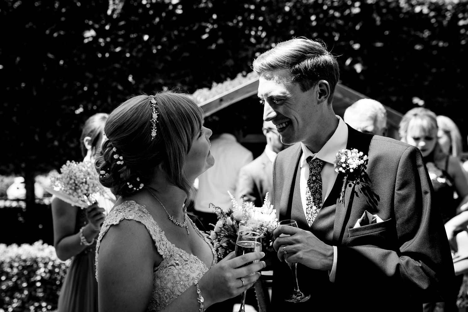 wedding guests congratulating the bride by Warwick House Wedding Photography