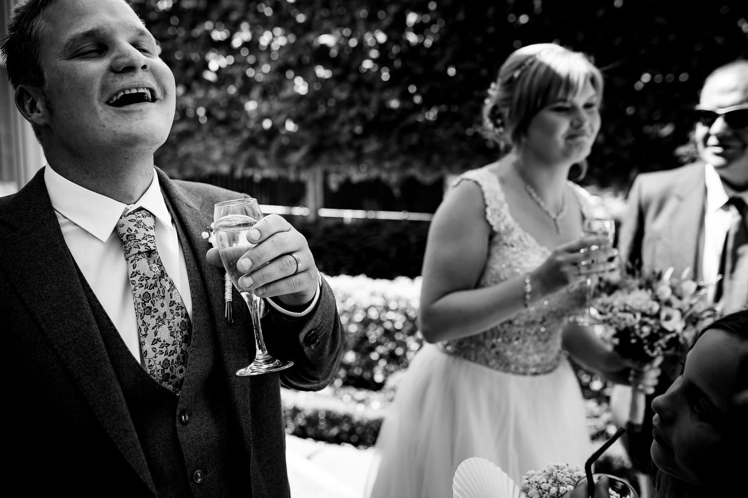 Warwick House Wedding Photography captures grooms cracking a joke