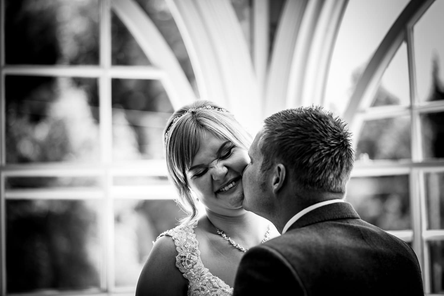 Warwick House Wedding Photography captures grooms kissing bride on the cheek
