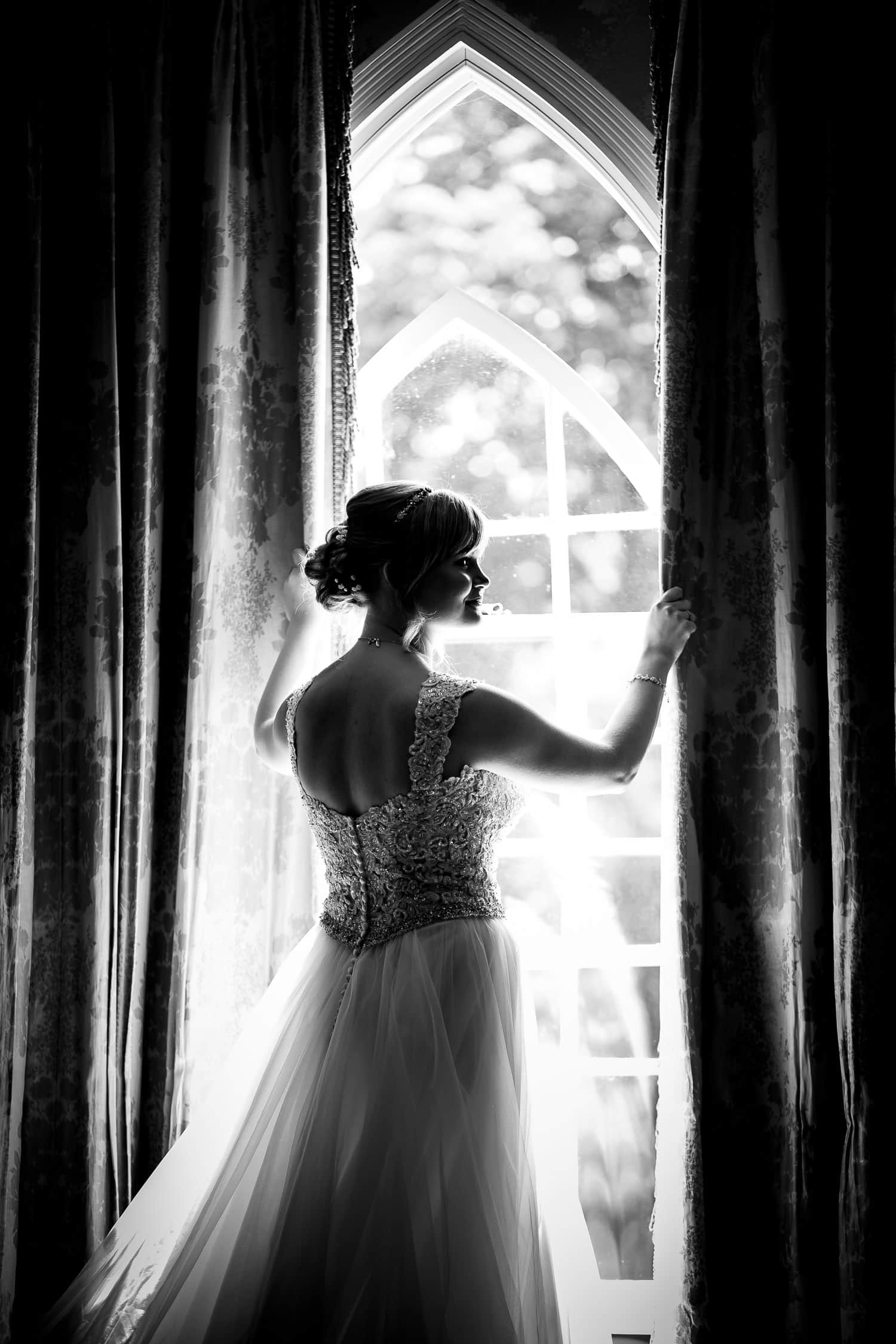 Chapter One Photography captures beautiful silhouette of bride in the window