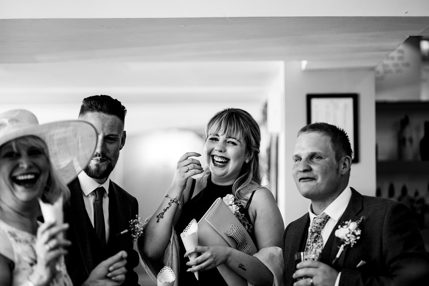 Warwick House Wedding Photography captures happy wedding guests laughing