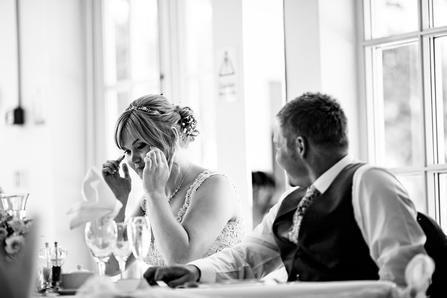 emotional bride wiping tears from her eyes by Warwick House Wedding Photography
