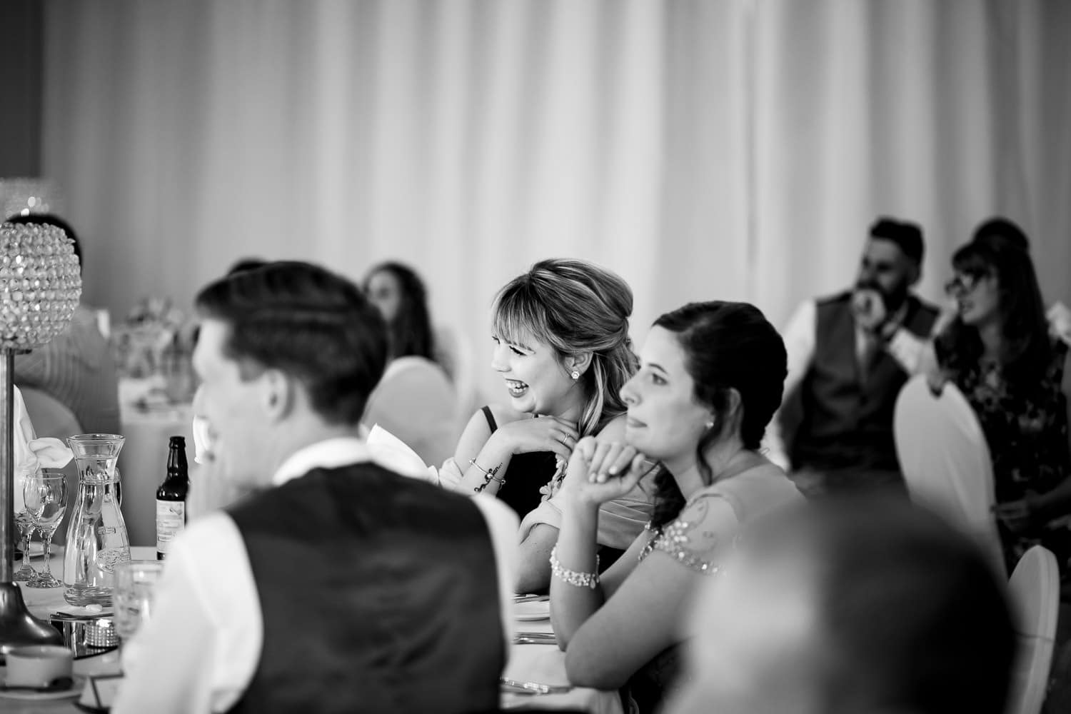 Warwick House Wedding Photography captures guests smiling during speehes