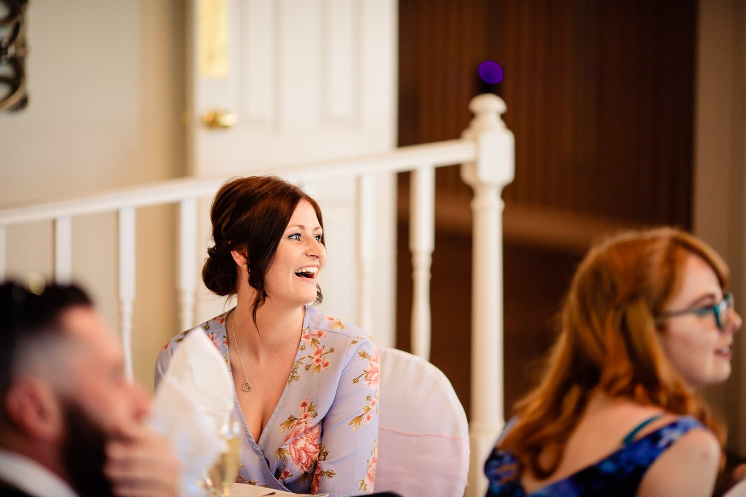 Warwick House Wedding Photography captures happy wedding guest during speeches