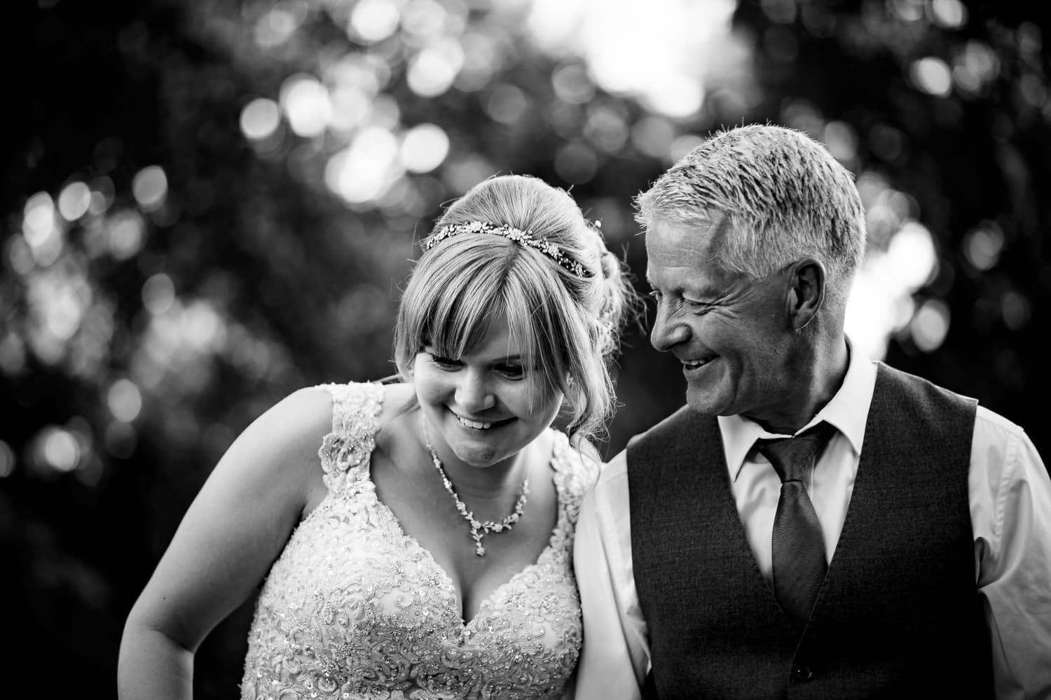 Warwick House Wedding Photography captures happy bride and dad smiling