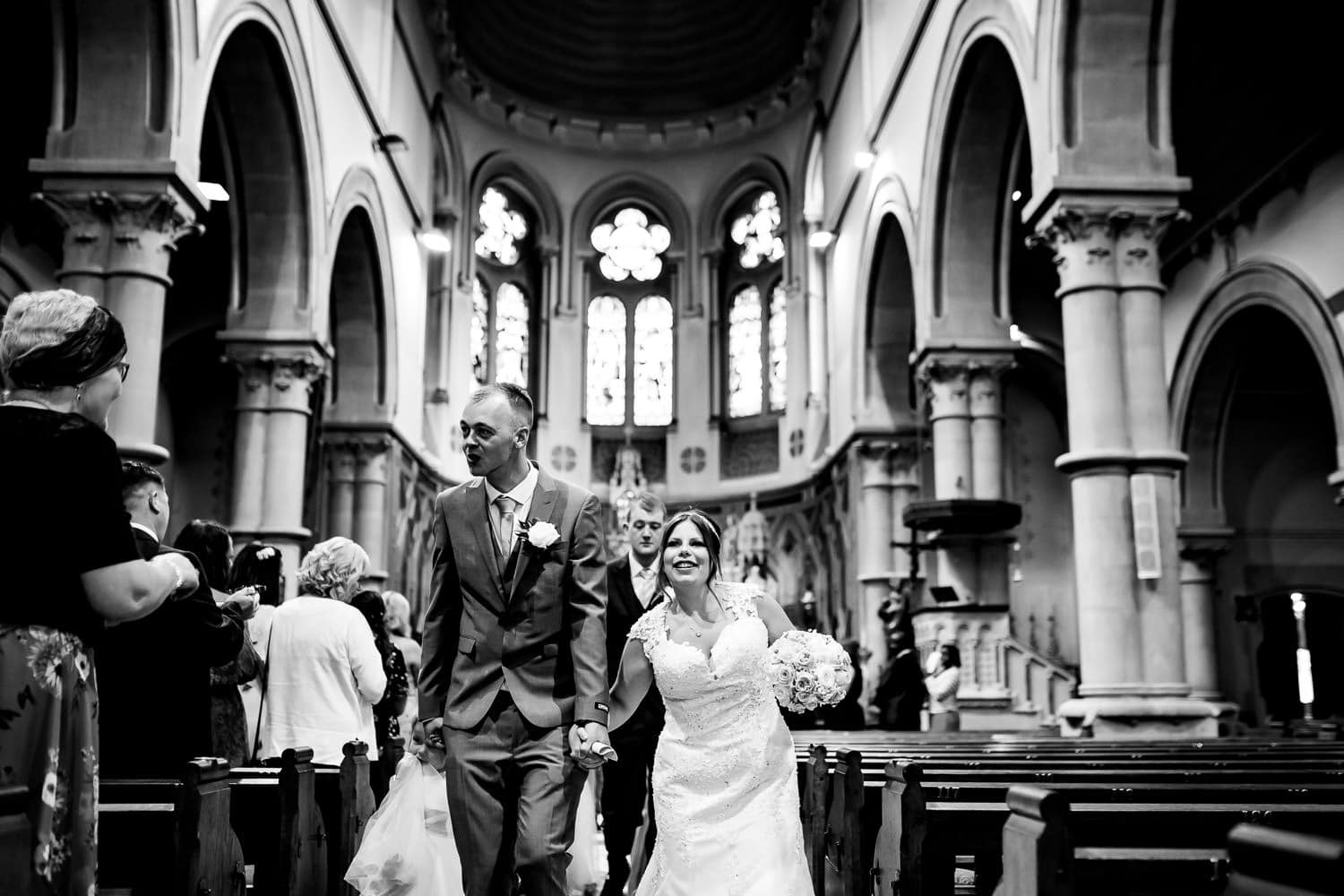 newlyweds walk down the aisle captures by Warwickshire Wedding Photographers