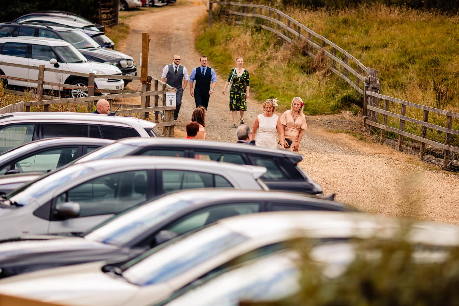 Wedding guests arriving at the Granary at Fawsley Wedding venue in northamptonshire