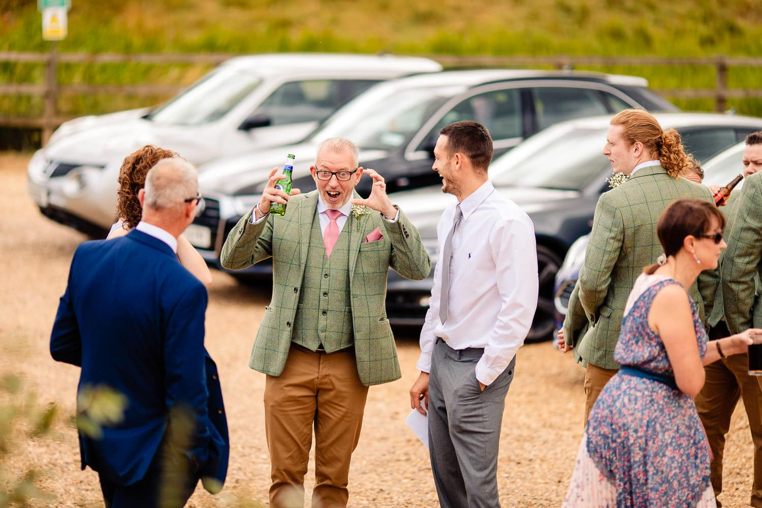 The Granary at Fawsley Wedding guests chatting