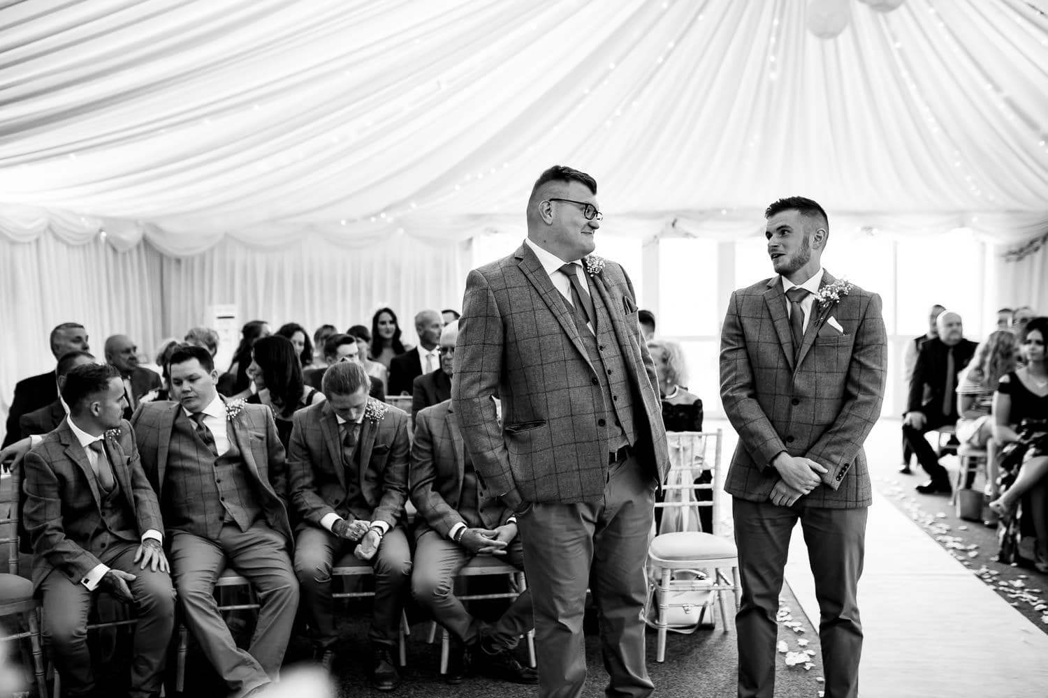 groom and best man share banter before the ceremony at the Granary at Fawsley Wedding