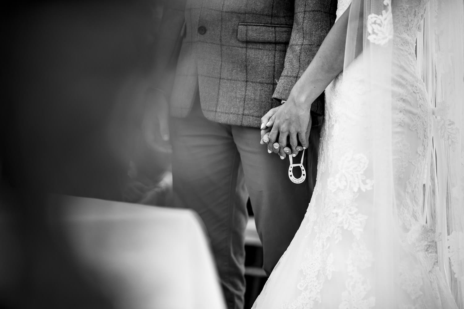 The Granary at Fawsley Wedding couple holding hands by chapter one photography