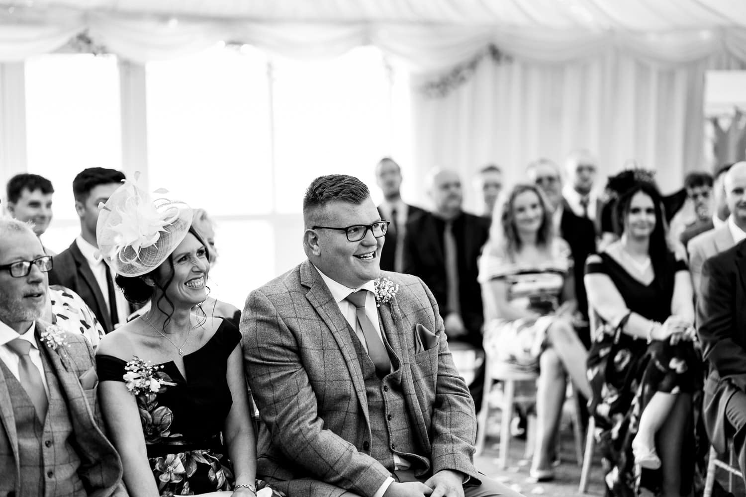 The Granary at Fawsley Wedding party smiles during ceremony by chapter one photography