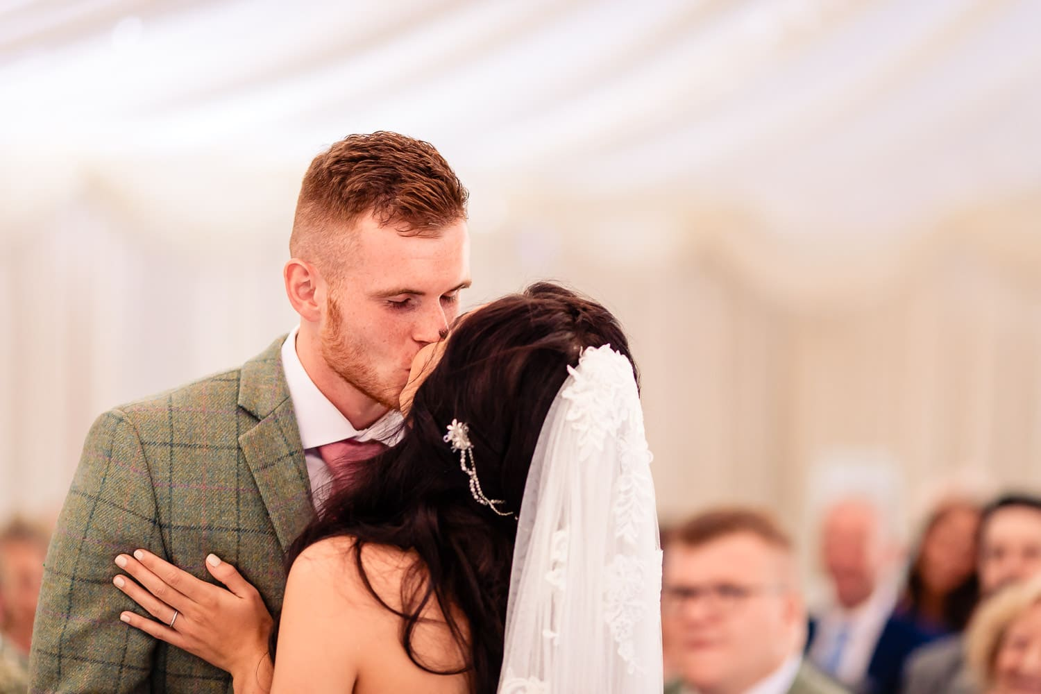 first kiss by chapter one photography at The Granary at Fawsley Wedding barn in northamptonshire