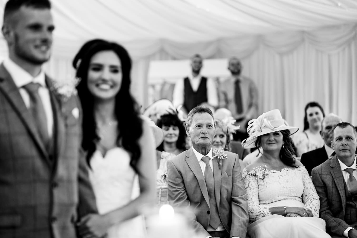 Beautiful bride and groom smile during ceremony at The Granary at Fawsley Wedding barns