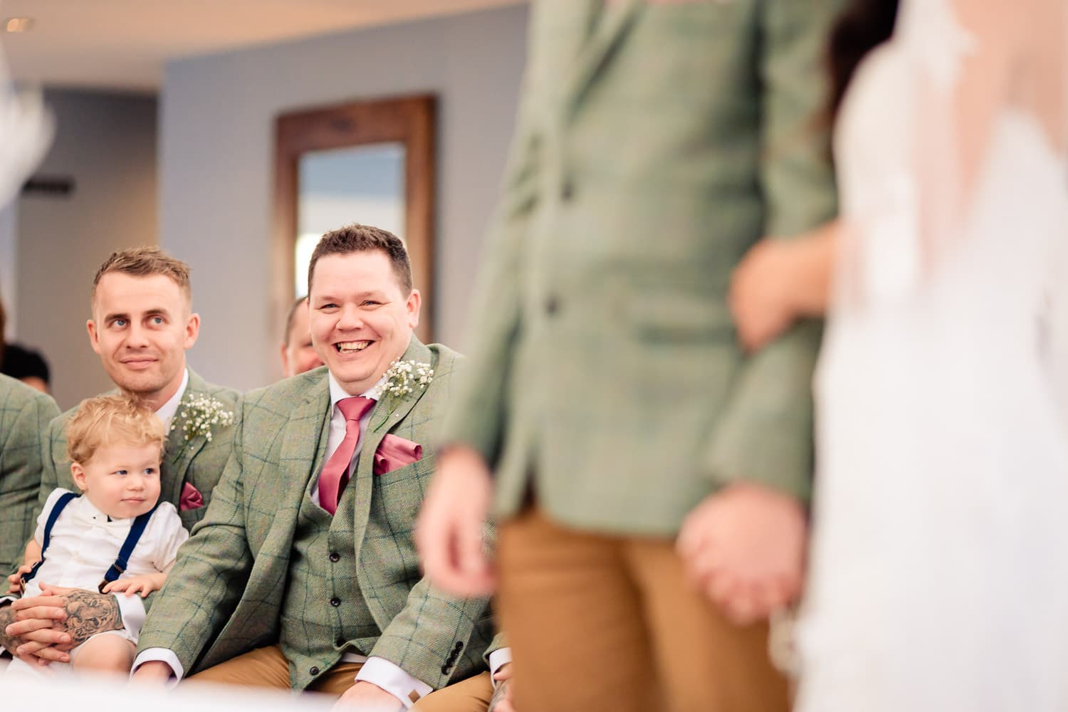 Grooms party share a joke during countrside wedding at The Granary at Fawsley Wedding barn
