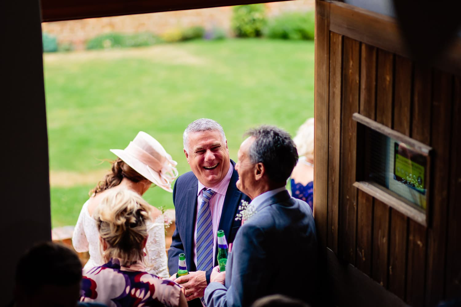 The Granary at Fawsley Wedding guests laughing and smiling