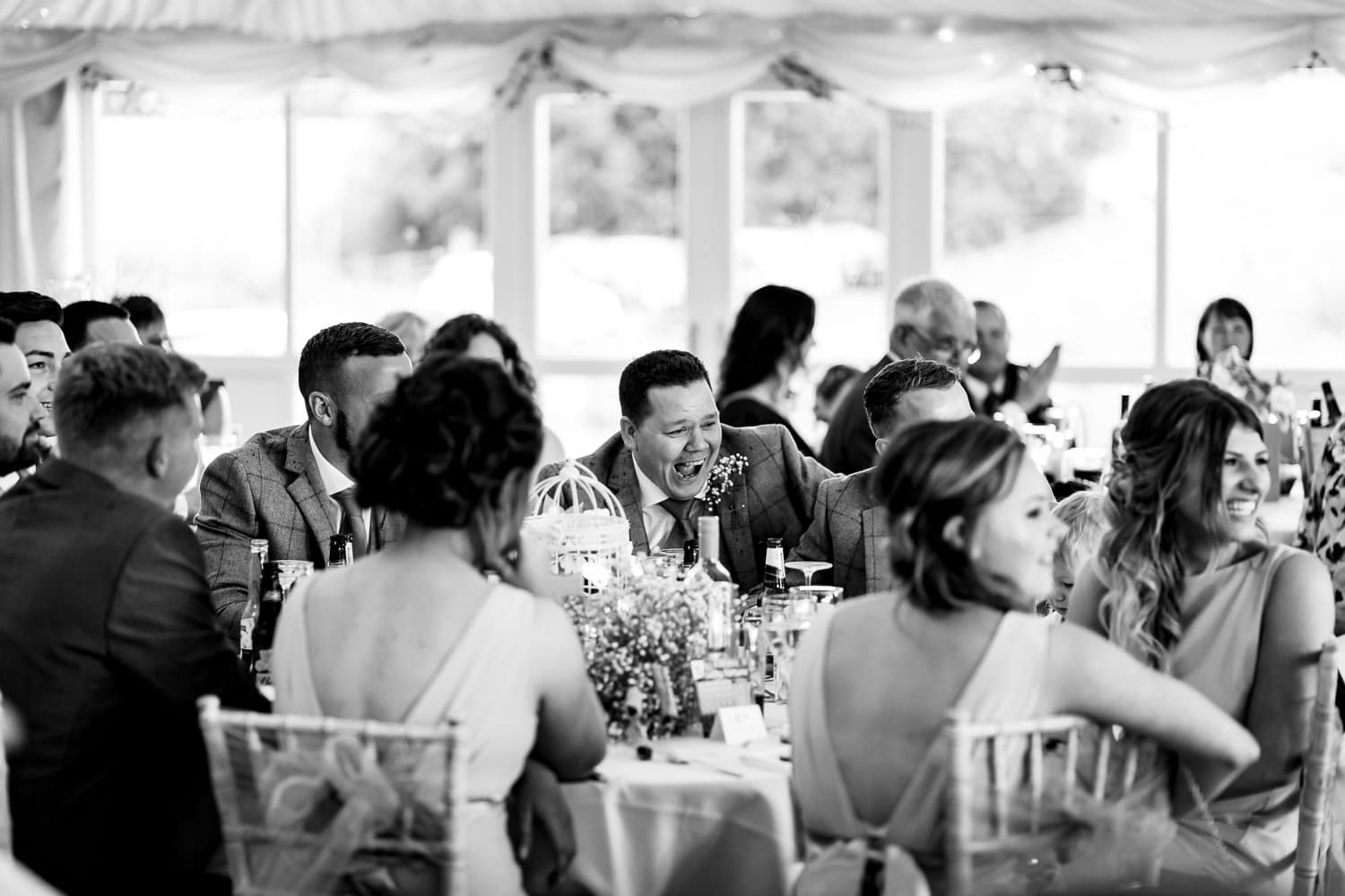 The Granary at Fawsley Wedding guests laugh during speeches