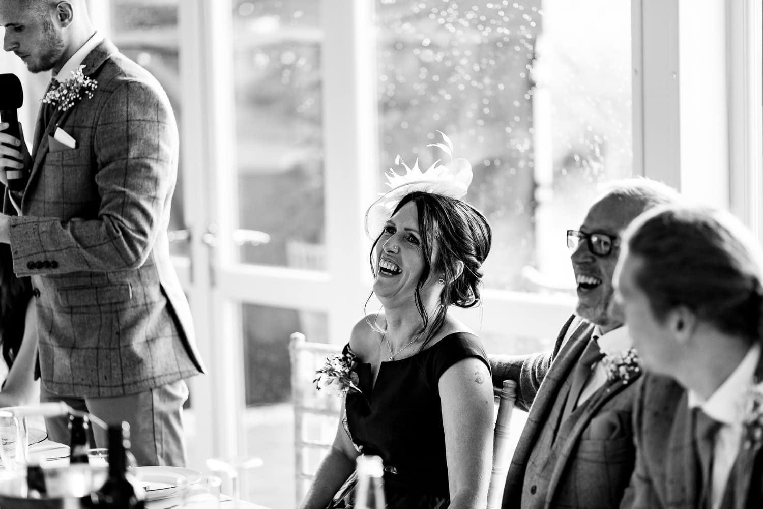 mother of the groom laughing at The Granary at Fawsley Wedding
