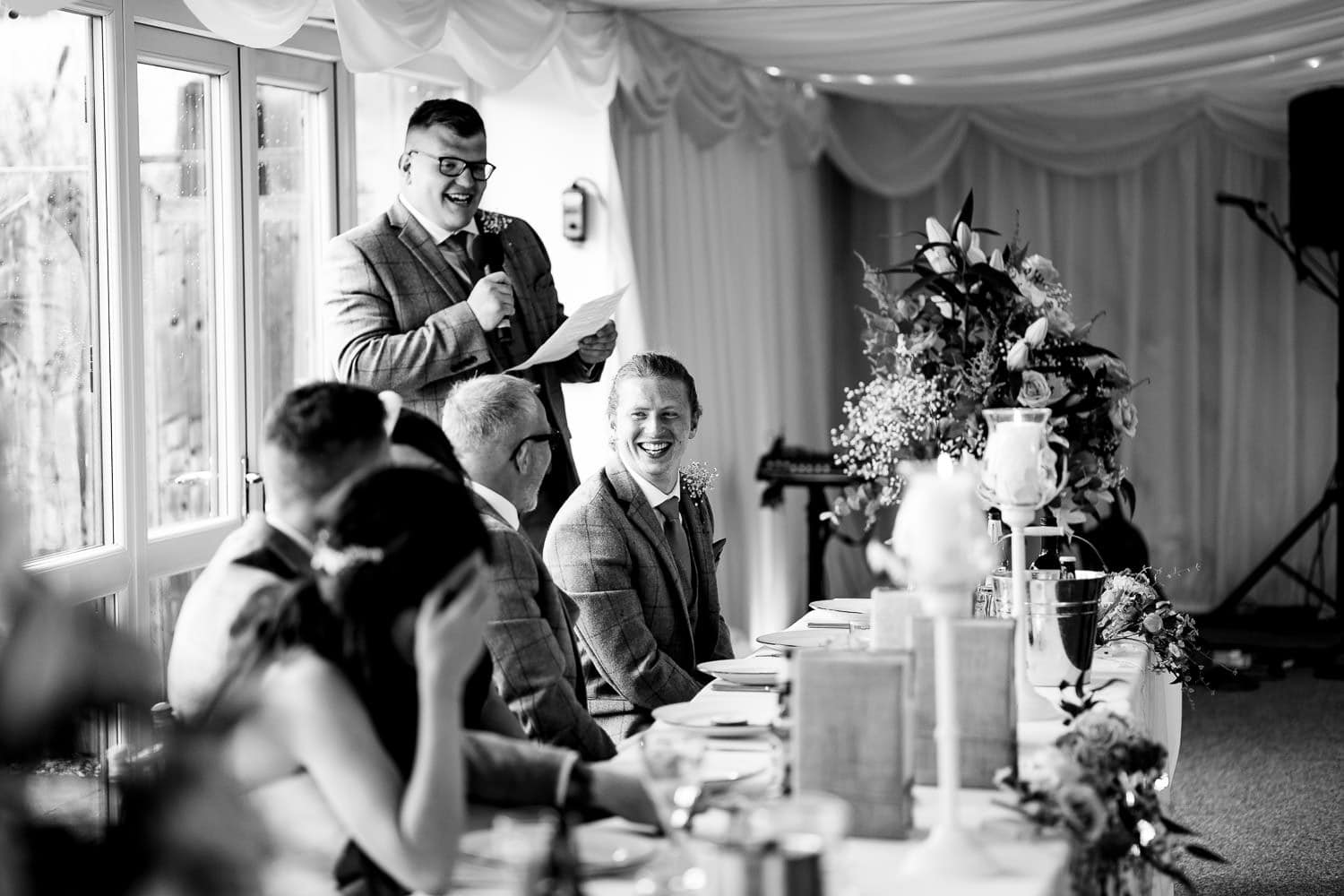 the grooms party share banter at The Granary at Fawsley Wedding hotel