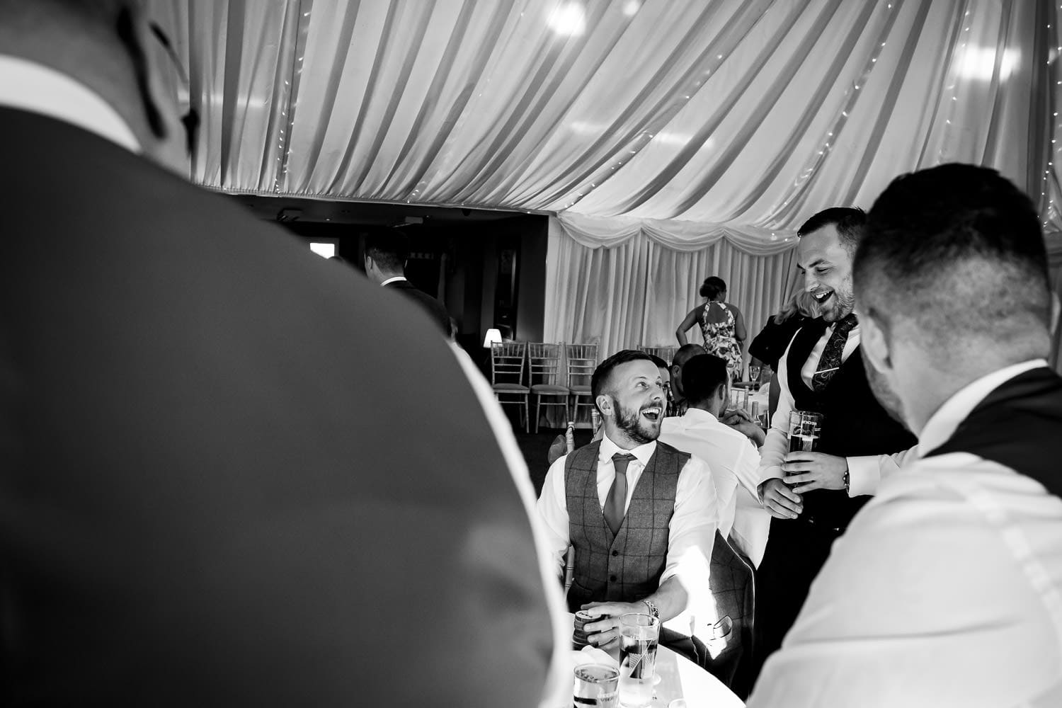 guys laughing loudly at The Granary at Fawsley Wedding reception