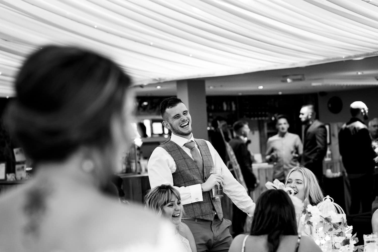 groom interacts with guests at The Granary at Fawsley Wedding reception