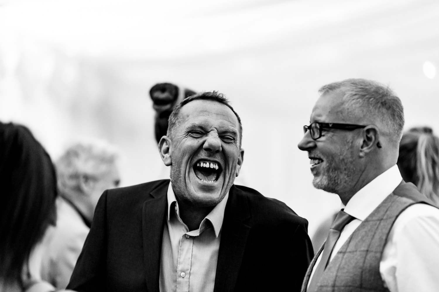 The Granary at Fawsley Wedding guests share a laugh