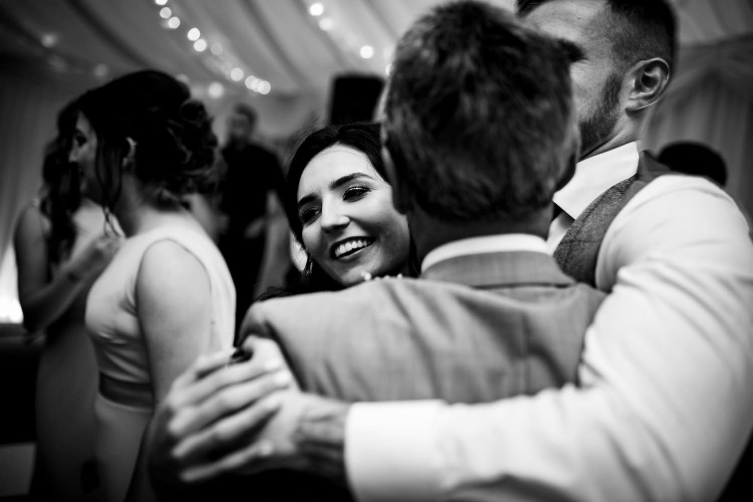 group hugging on the dance floor at The Granary at Fawsley Wedding