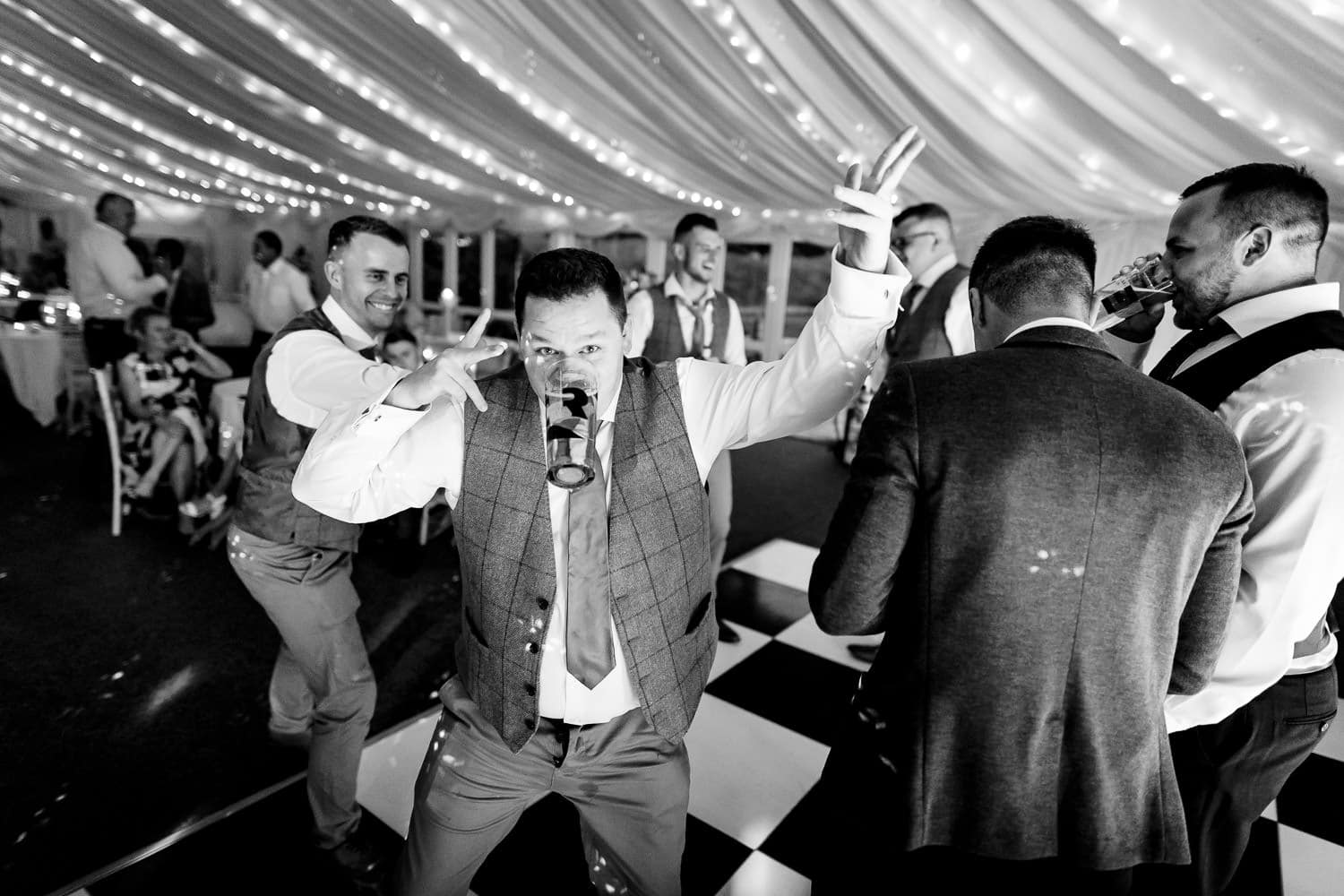 grooms party on the dance floor at The Granary at Fawsley Wedding barn