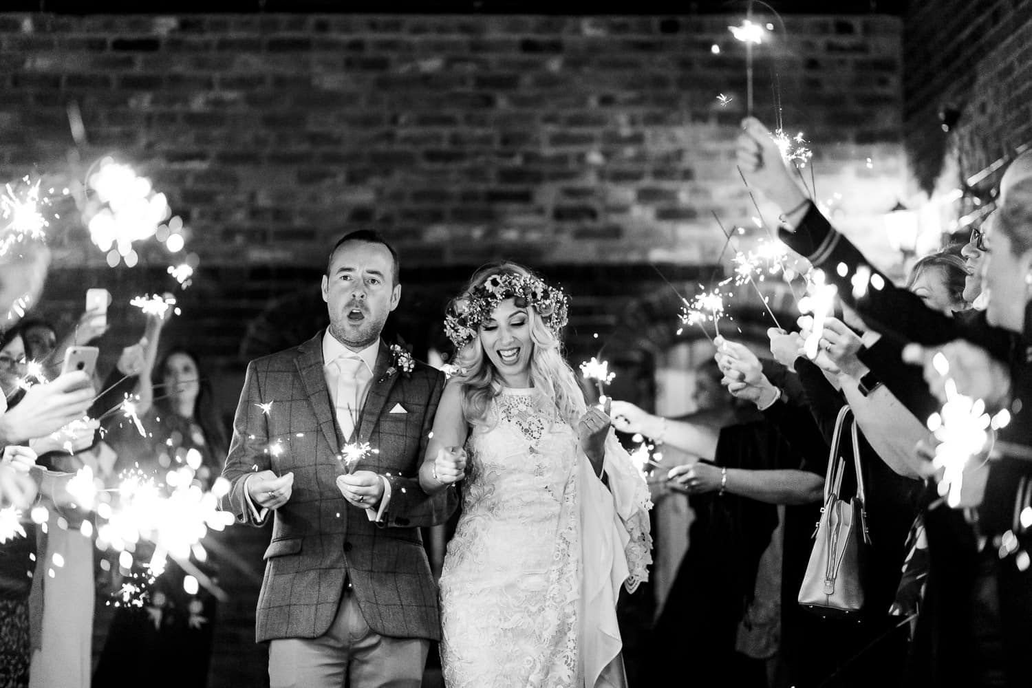 Sparklers during country house wedding
