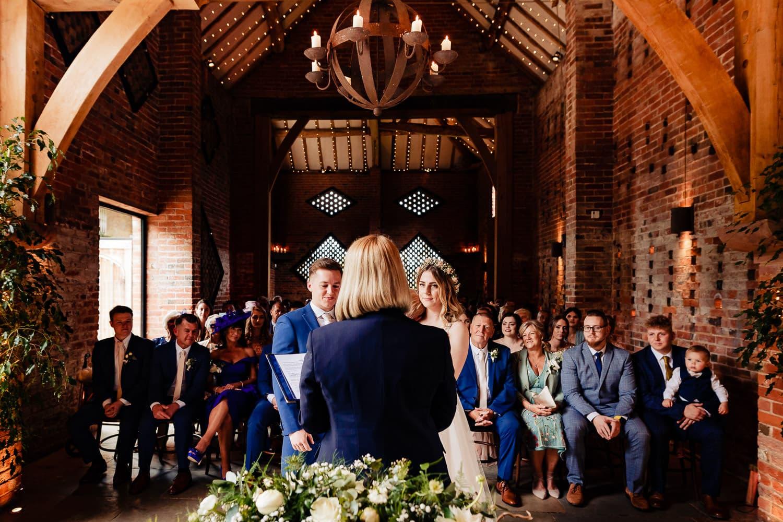 Weddign ceremony at Shustoke Barn in Warwickshireos